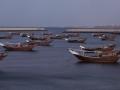 Tradiční dřevěné lodě v přístavním městě Sur